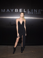 Devon Windsor sported a slinky black halter dress with an asymmetrical hem at the Maybelline NYFW welcome party.