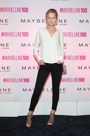 Toni Garrn showed off her supermodel legs in tight black jeans during Maybelline's 100th anniversary party.