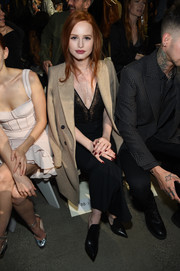 Madelaine Petsch sat front row at the Jonathan Simkhai Fall 2018 show wearing a tan wool coat over a black dress.