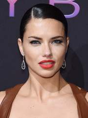 Adriana Lima coated her lips a sexy matte red hue.