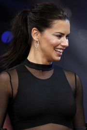 Adriana Lima pulled her hair back into a ponytail for the Maybelline New York show.