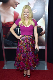 Megan Hilty completed her ultra-girly outfit with a colorful floral skirt.