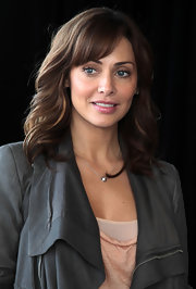 A wavy 'do with bangs sweetened up Natalie Imbruglia's look during the 'X Factor' media call.