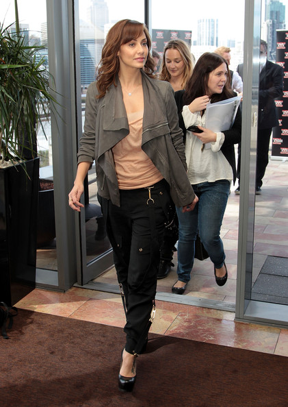 Natalie Imbruglia looked super trendy in her draped gray zip-up jacket during the 'X Factor' media call.