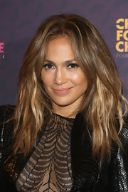 A subtle nude lip kept J. Lo's beauty look natural and glowing.