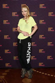 Iggy Azalea kept her look super casual with a neon yellow crewneck and slouchy sweatpants.