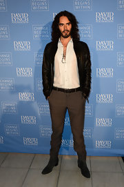 Russell Brand looked quite dapper in this black leather bomber paired over a button down shirt.
