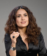 Salma Hayek finished off her look with wild curls.