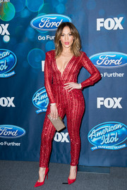 Jennifer Lopez was her usual va-va-voom self in a plunging red jumpsuit by Zuhair Murad Couture during the 'American idol XV' finalists presentation.