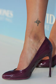 Megan Gale showed off a sun tattoo during the reopening of David Jones.