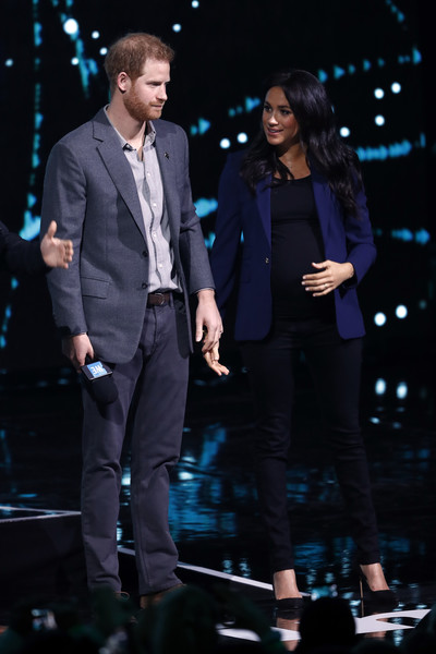 Meghan Markle Skinny Jeans [performance,suit,event,formal wear,music artist,performing arts,tuxedo,outerwear,talent show,stage,harry,meghan,stage,london,sussex,duchess,england,sse arena,we day uk,duke of sussex]