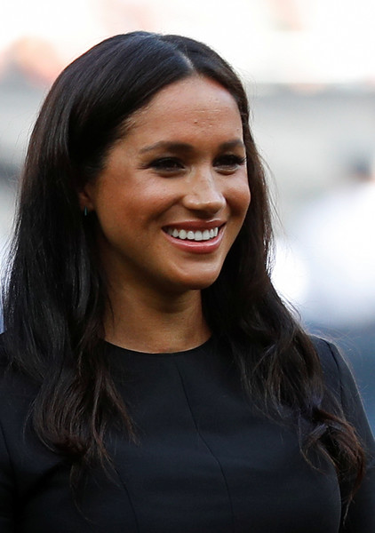 Meghan Markle Long Center Part [game,hair,face,facial expression,hairstyle,smile,beauty,eyebrow,lady,chin,lip,meghan,support,london stadium,sussex,boston red sox,vs new york yankees,duke of sussex attends,baseball game,baseball game]