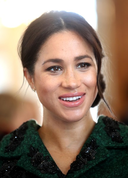 Meghan Markle Chignon [hair,face,eyebrow,smile,hairstyle,beauty,chin,lip,forehead,black hair,meghan,prince harry,community,canada house,london,sussex,duchess,duke and duchess of sussex,duke of sussex,commonwealth day youth event]