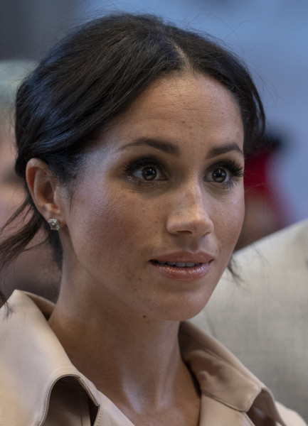Meghan Markle Loose Bun [hair,face,hairstyle,eyebrow,chin,forehead,beauty,nose,skin,lip,nelson mandela,meghan,life,times,centenary,duchess,southbank centre,sussex,the duke duchess of sussex visit the nelson mandela centenary exhibition,nelson mandela centenary exhibition]