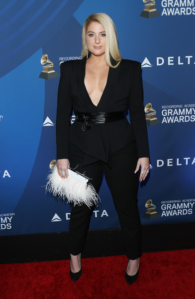 Meghan Trainor Feathered Clutch [delta air lines celebrates 2019 grammys with private reception and performance,suit,clothing,carpet,pantsuit,red carpet,formal wear,premiere,tuxedo,flooring,footwear,ella mai,meghan trainor,grammys,california,los angeles,mondrian hotel,delta air lines]