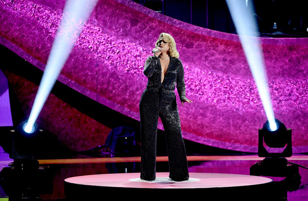 Meghan Trainor Jumpsuit [performance,pink,purple,stage,fashion,performing arts,event,violet,public event,lighting,q85: a musical celebration for quincy jones,california,los angeles,microsoft theatre,meghan trainor]