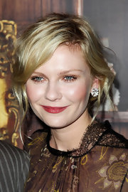 Kirsten Dunst wore a subtle berry shade of lipstick at the 'Melancholia' premiere. Clinique Almost Lipstick in Black Honey will create a similar effect.