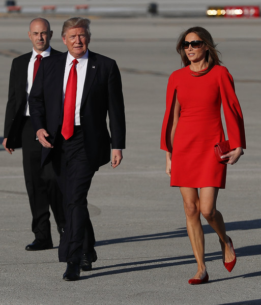 Melania Trump Quilted Clutch [suit,clothing,red,formal wear,dress,fashion,standing,tuxedo,white-collar worker,footwear,donald trump,melania trump,president,air force one,palm beach,u.s.,tarmac,palm beach international airport,the weekend,visit]
