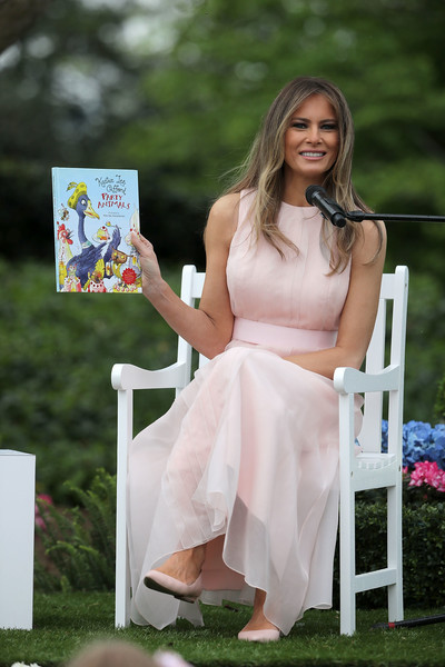 Melania Trump Pointy Flats [party animals,lady,beauty,dress,leg,event,photography,sitting,long hair,melania trump,trump,rutherford b. hayes,eggs,white house,lawn,u.s.,south lawn,easter egg roll]