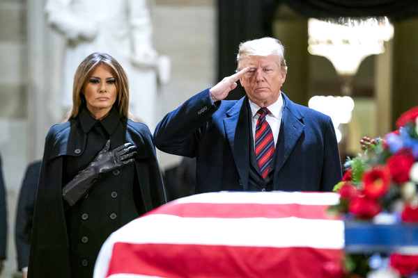 Melania Trump Leather Gloves [red,event,ceremony,official,outerwear,flag,tradition,flower,bush,george h.w.,donald trump,melania trump,members,respects,u.s. capitol,u.s. capitol rotunda,state,bush lies in state]