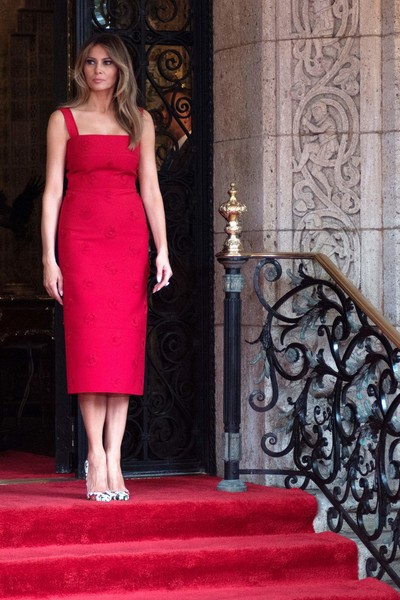 Melania Trump Pumps [photo,dress,pink,flooring,lady,cocktail dress,beauty,gown,shoulder,carpet,girl,xi jinping,donald trump,melania trump,peng liyuan,mar-a-lago,dress,chinese,estate,united states of america,melania trump,dress,valentino spa,clothing,united states of america,first lady of the united states,fashion,gown,red]