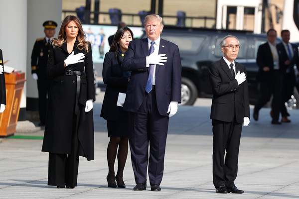 Melania Trump Wool Coat [event,suit,white-collar worker,businessperson,uniform,job,formal wear,employment,official,bodyguard,melania trump,donald trump,salute,part,south korea,u.s.,national cemetery,asian,seoul,tour]