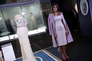 Melania Trump topped off her dress with a pink wool coat.