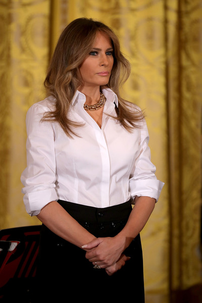 Melania Trump Button Down Shirt [music,white,clothing,lady,long hair,blond,fashion,formal wear,brown hair,blouse,photography,melania trump hosts a celebration of militarymothers,melania trump,mothers,u.s.,white house,east room,event,event,national military spouse appreciation day]