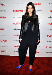 Katherine Schwarzenegger layered a black leather jacket over a baggy jumpsuit for Brian Atwood's celebration of PUMPED.