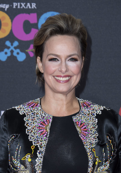 Melora Hardin Fauxhawk [photo,hair,hairstyle,premiere,blond,smile,event,makeover,brown hair,long hair,fashion accessory,coco,melora hardin,arrivals,valerie macon,california,disney pixar,afp,premiere,premiere]