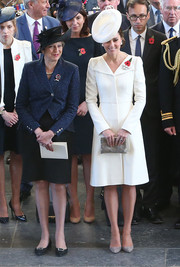 Kate Middleton paired a silver clutch by Anne Grand-Clement with a white coat dress for the Passchendaele commemorations in Belgium.