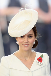 Kate Middleton polished off her flawless look with a white sinamay hat by Sylvia Fletcher for Lock & Co.