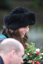 Kate Middleton kept warm in luxurious style with a black fur hat while attending Christmas Day church service.
