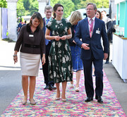 Kate Middleton looked demure in a green and white floral midi dress by Rochas at the RHS Chelsea Flower Show.