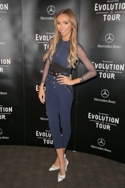 Giuliana Rancic made an appearance at the Mercedes-Benz Evolution Tour wearing a sheer-sleeve blue jumpsuit by Three Floor.