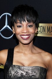 Anika Noni Rose was summer-chic with her pixie cut at the Mercedes-Benz 217 Oscar-viewing party.