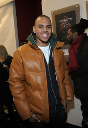Chris Brown was all smiles in a Puffa leather Jacket as he attended New York Fashion Week.