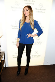 Giuliana wore a gold cuff bracelet with her vibrant blue top at NYFW.
