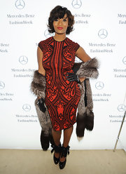 Toccara Jones pulled off a classy look at Fashion Week wearing a red ornately printed dress.