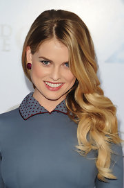Actress Alice Eve paired her cocktail dress with ruby button earclips, in 18kt white gold.