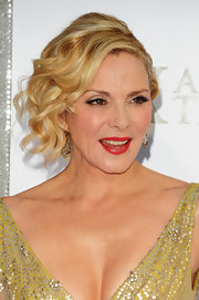 Kim Cattrall showed off her pinned up ringlets while attending the Sex and the City premiere.