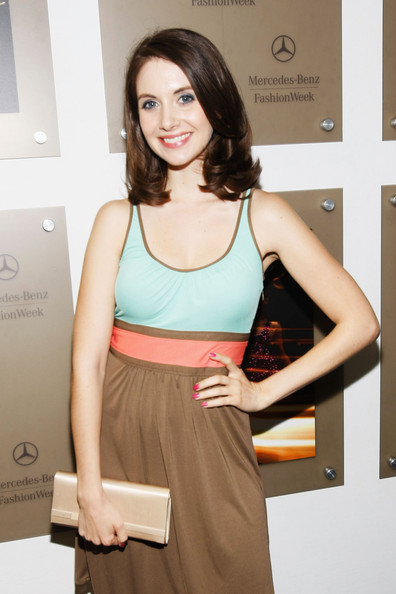 Alison Brie's nude satin clutch was a classy finish to her outfit during Mercedes-Benz Fashion Week.