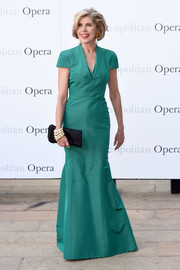 Christine Baranski cut a stylish figure at the Met Opera opening performance of 'Tristan und Isolde' wearing this green gown featuring a subtle mermaid silhouette.