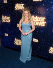 Amy Schumer wowed in a curve-hugging blue sequin gown by Akris at the 'Meteor Shower' Broadway opening.