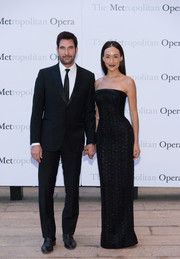 Maggie Q attended the Metropolitan Opera opening night of 'Otello' wearing a textured strapless gown that hugged her curves in all the right places.