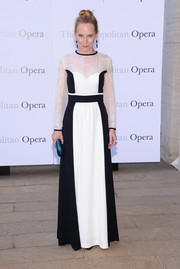 Amy Ryan donned a long-sleeve black-and-white evening dress by Alberta Ferretti for the 'Eugene Onegin' opening.