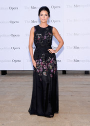 Katie Lee looked fetching at the 'Eugene Onegin' opening in a sleeveless black evening dress with a subtle floral print.