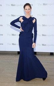 Coco Rocha showed off her modern style in a frilly blue gown with shoulder cutouts during the 'Eugene Onegin' opening.
