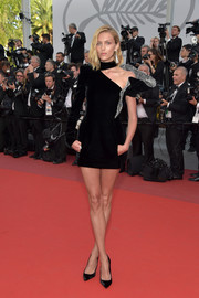 Anja Rubik cut a striking figure in a Saint Laurent cutout LBD with crystal detailing at the Cannes Film Festival screening of 'The Meyerowitz Stories.'