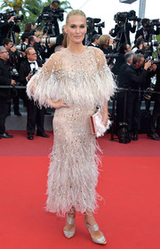 Molly Sims looked dreamy in a beaded and feathered Monique Lhuillier dress at the Cannes Film Festival screening of 'The Meyerowitz Stories.'